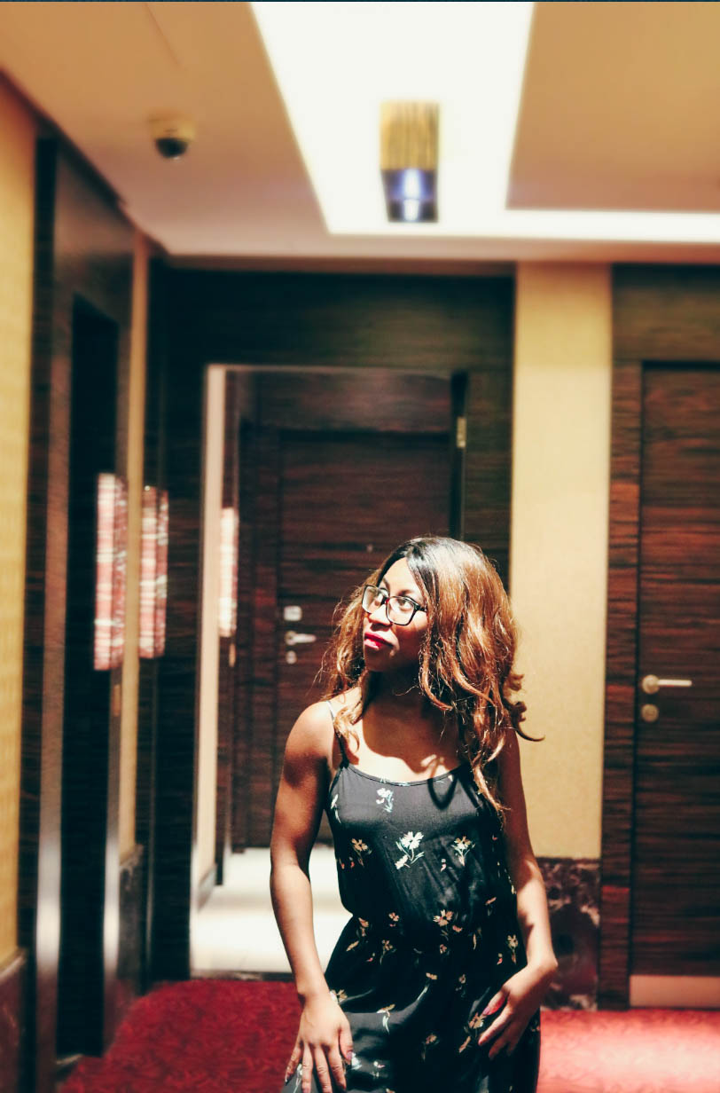 The Atana Hotel Dubai Hallway with me standing and posing in the hallway mid shot.