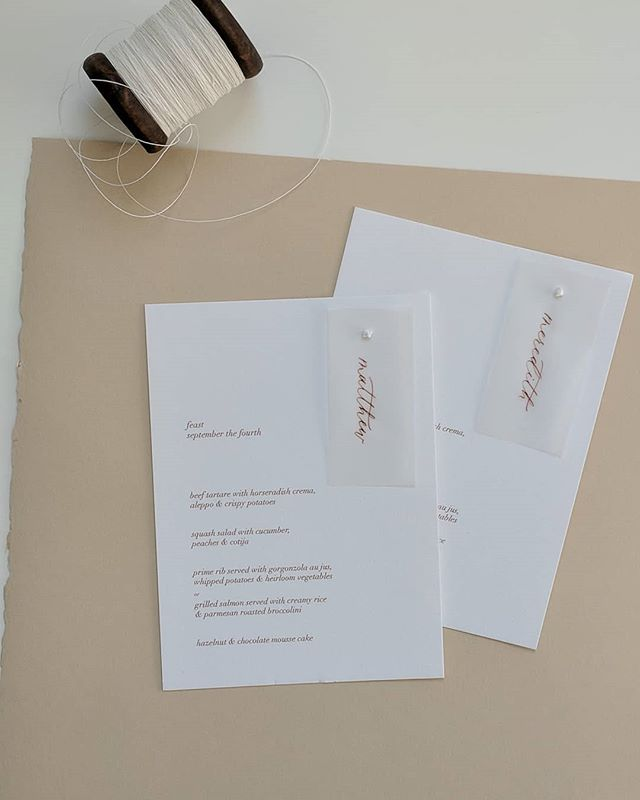 Custom menus with vellum name tags. I am dying to make some more of these, secured with the perfect little embroidery knot.