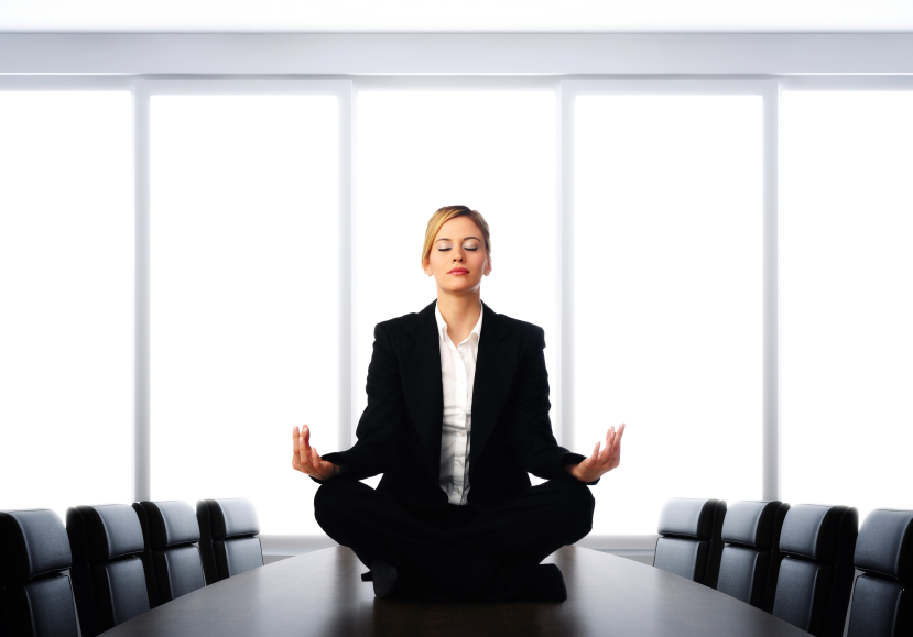 Business-woman-meditating-on-desk.jpg
