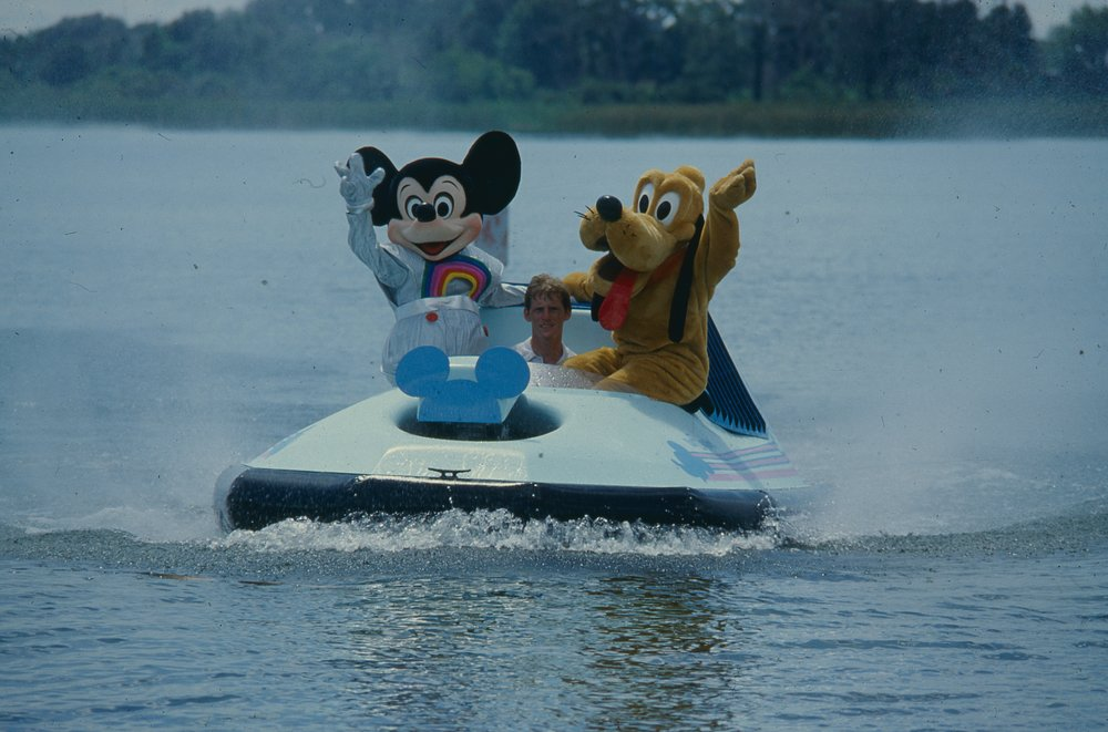 1985 Mickey and Goofy Operating a Neoteric LeMere Craft to Promote Disney's Epcot Hovercraft Dragon Show.