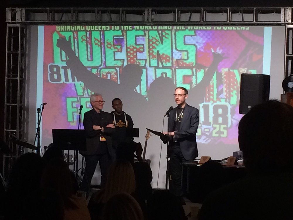 "Clayton accepts the Kodak Award for ""Best Work Shot on Film"" at the 2018 Queens World Film Festival"
