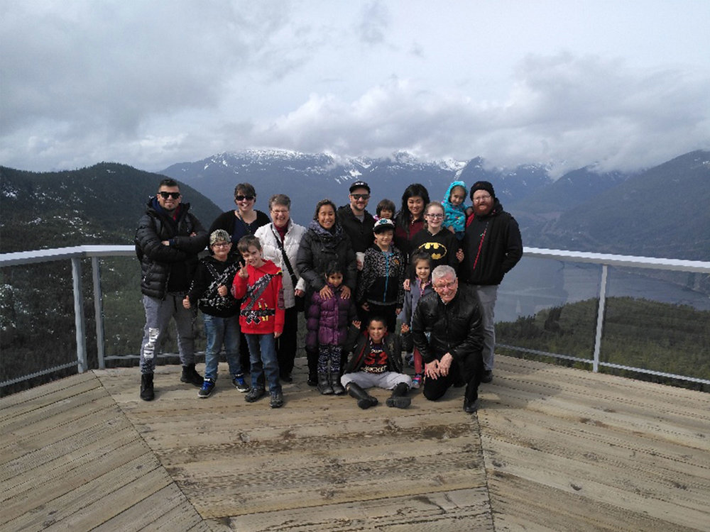Sharon and Darrell with their family: Marissa, who was adopted in the Philippines and has two kids; Christy, who's Korean and has three kids; and David, who's half-Mexican and half-Caucasian and has four kids.