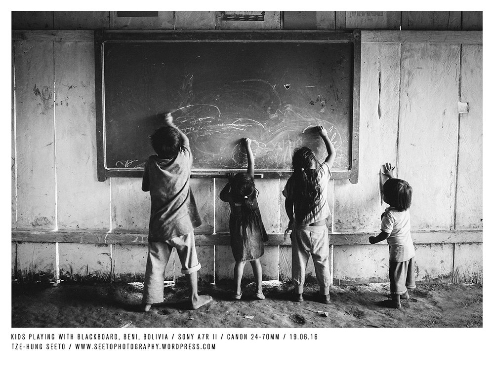 Bolivia, Oromomo, Kids playing with blackboard_CP.jpg