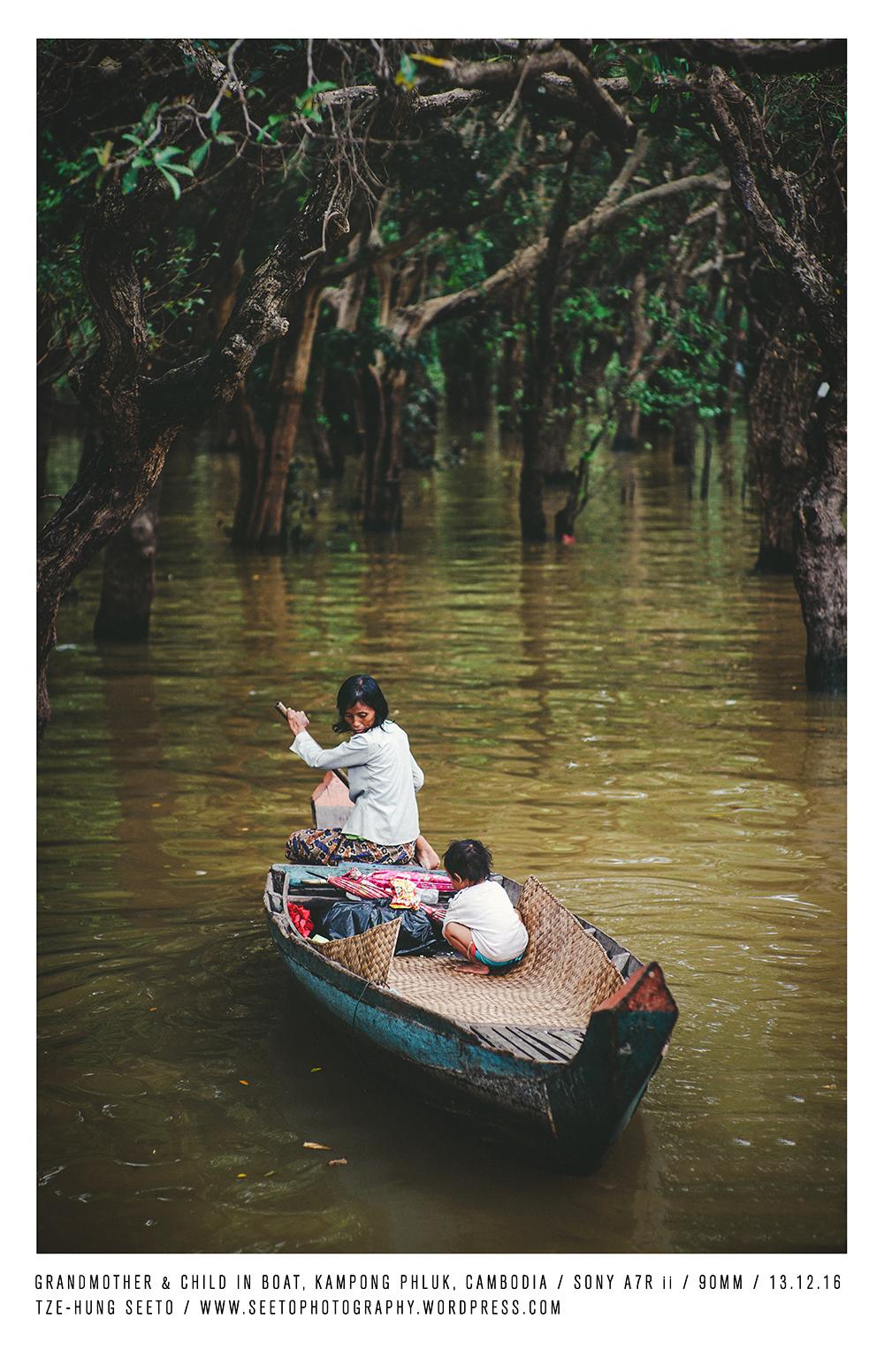 Cambodia, Kampong Phluk, Grandmother & child in Boat_CP.jpg