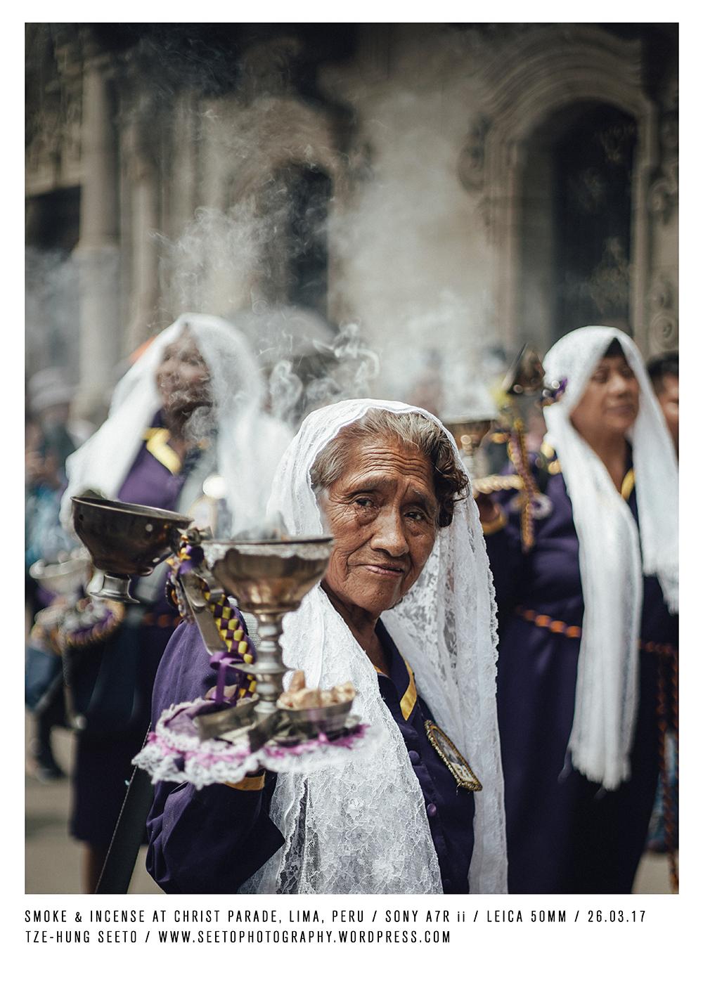Peru, Lima, Old lady with smoke at parade_CP.jpg