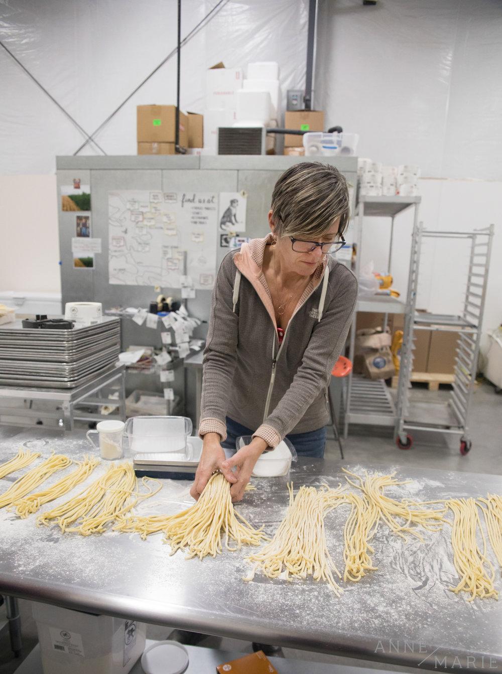 Katie sorts the pasta.