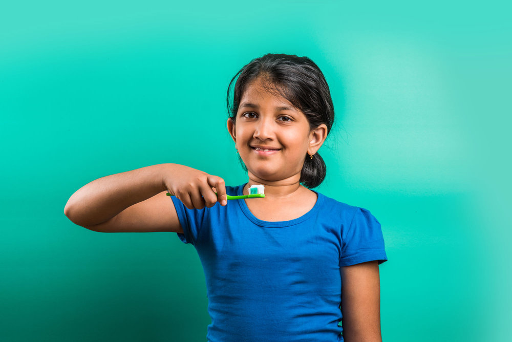 bigstock-indian-girl-and-tooth-brush-i-117985334WEB.jpg