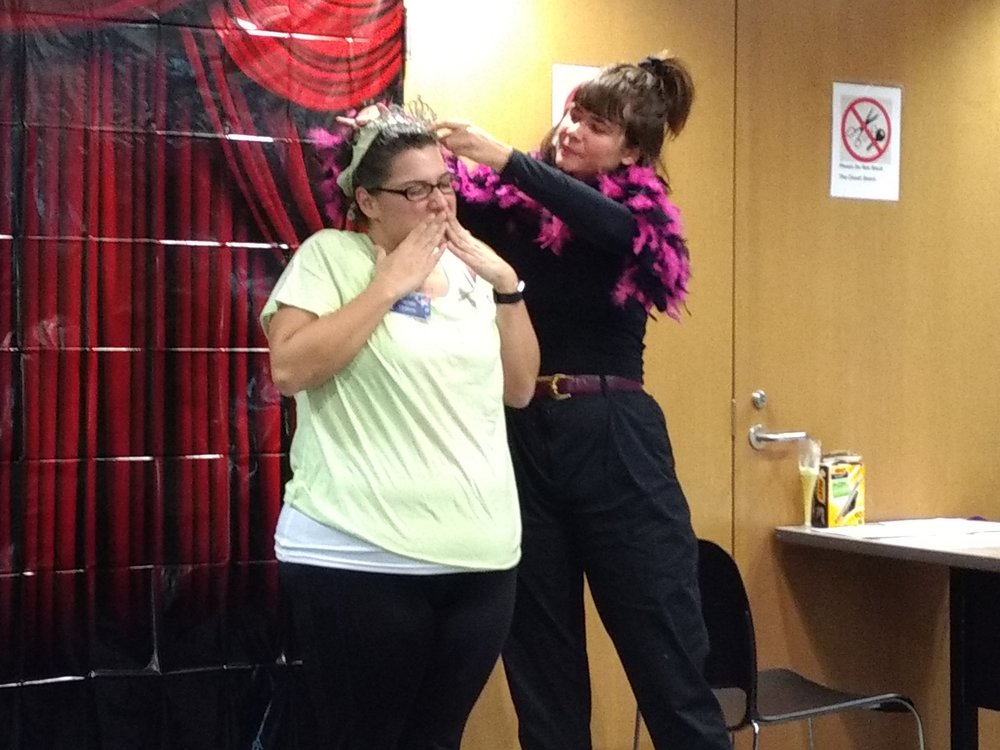 "Earlier this month during Resident Director training, I joined in for a murder mystery event! Here I am crowning the prom queen at our fake prom where the ""murder"" took place. It's always fun getting to better know the RDs in Housing and Residence Education. We're working together on the new installation that I'm making for the first-year residence halls."