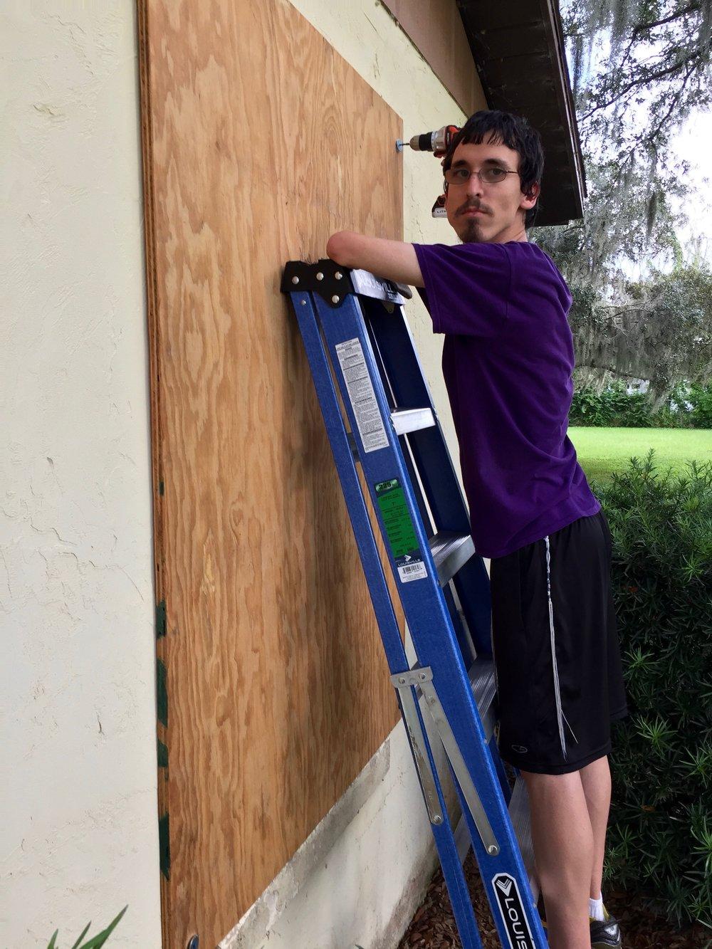 Mihai Marston boards a window. (Glenn Marston)