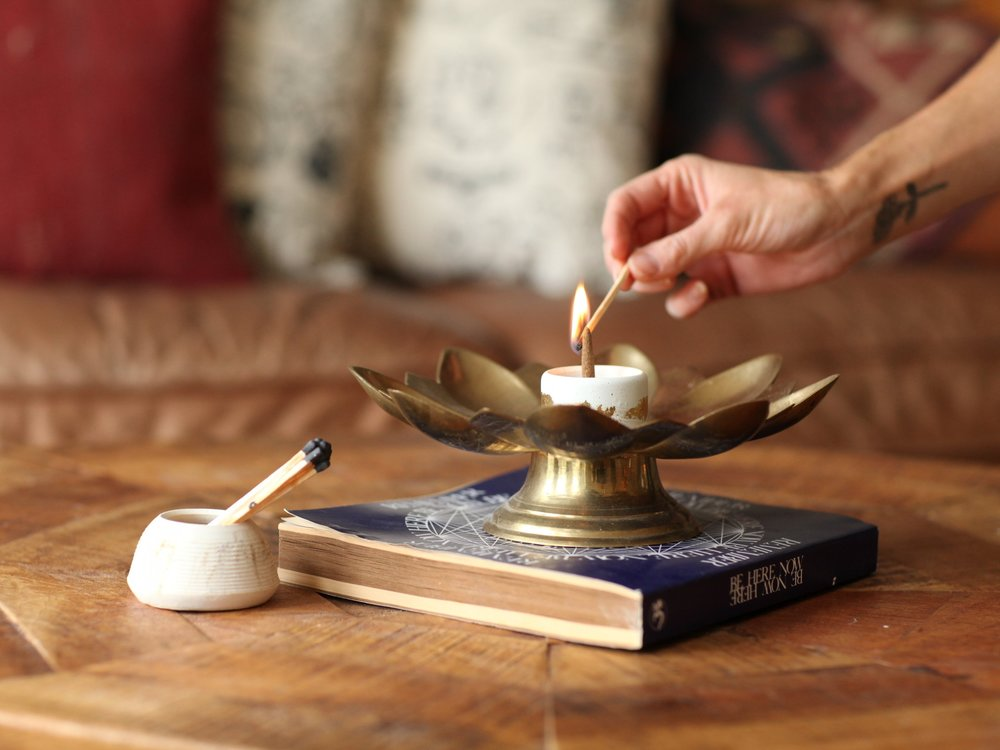 burn bright - We carry hand rolled incense in a variety of scents for your home and cute holders--both sticks and cones.
