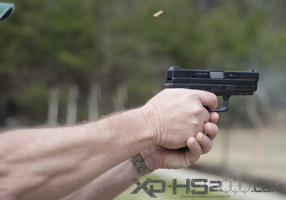 A side view live firing the Advantage Arms Springfield Armory XD 22LR conversion kit.