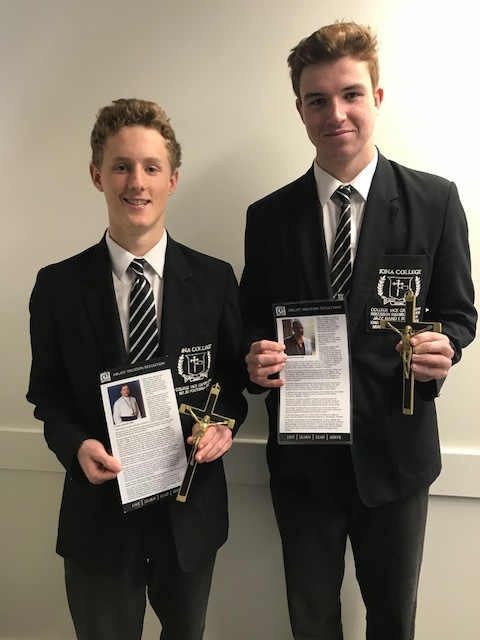 Faith and Mission Vice-Captain Matthew Lynch (Left) and Community Activities Vice-Captain Tyler Hocking (Right) with the crosses of Fr John Hannah OMI and Fr Michael Clarke OMI.