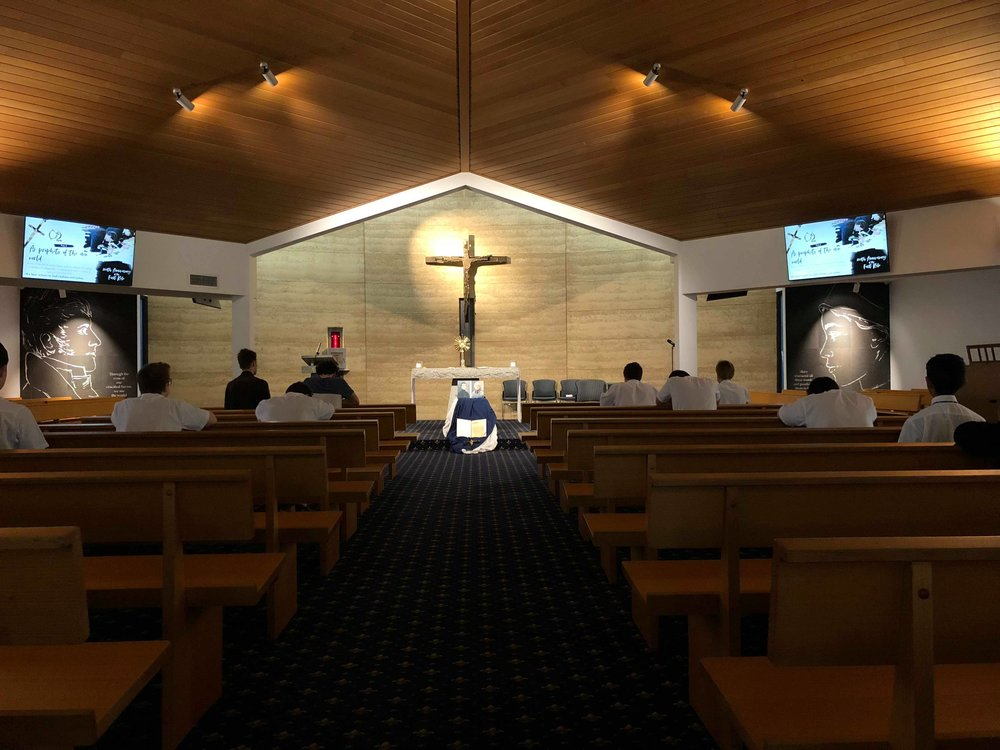Students at Mazenod College VIC reflecting on the Oblate rule in adoration