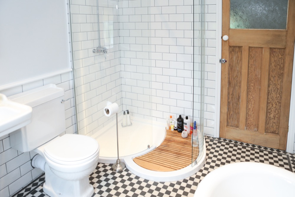Classic roll-top bath and walk-in shower. Emperor Bathrooms limited.