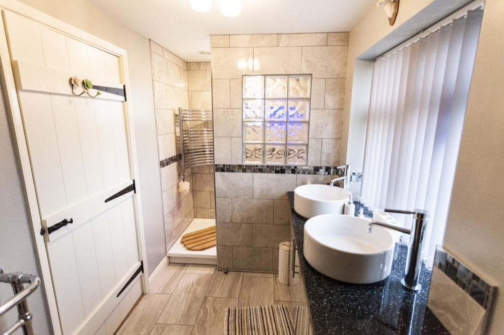 double basin with walk-in shower. Emperor Bathrooms.