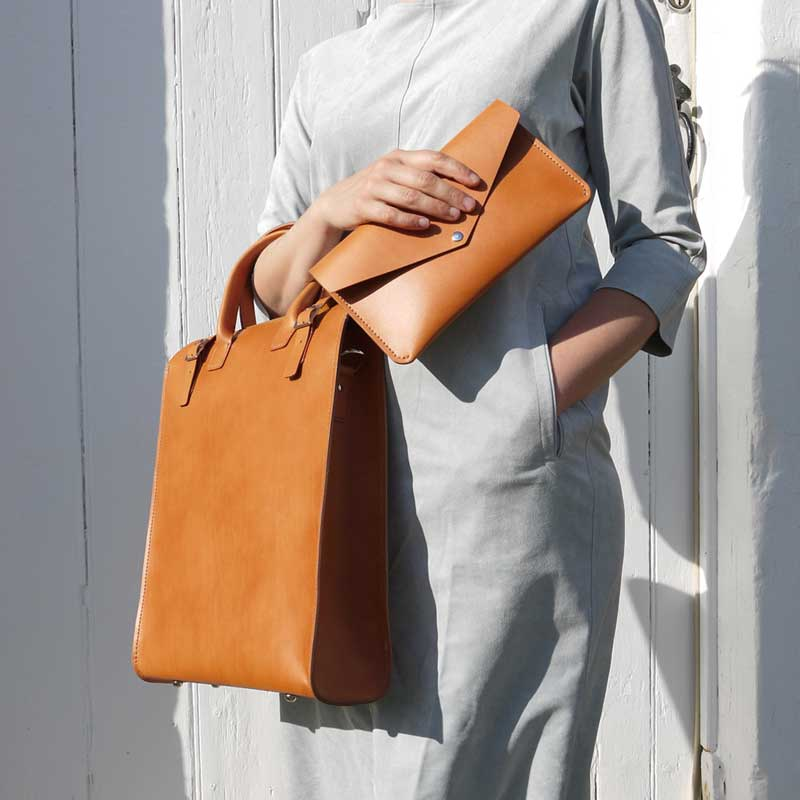 """Basäder - Harrisville, NHBasäder is a small women-owned company, based in Harrisville, New Hampshire. We produce timeless leather bags and accessories. Our philosophy is to create """"slow-fashion"""" leather goods with a clean, minimalist look, that are practical and functional to the needs of our customers. Everything we produce is designed in-house and crafted by hand to last a lifetime. We always use the finest full-grain, vegetable-tanned leather, leaving us with the smallest ecological footprint possible in terms of leather production. We have a strong commitment to being eco-conscious, and make sure we source everything from ethical, American companies.www.basader.com   @basader"""