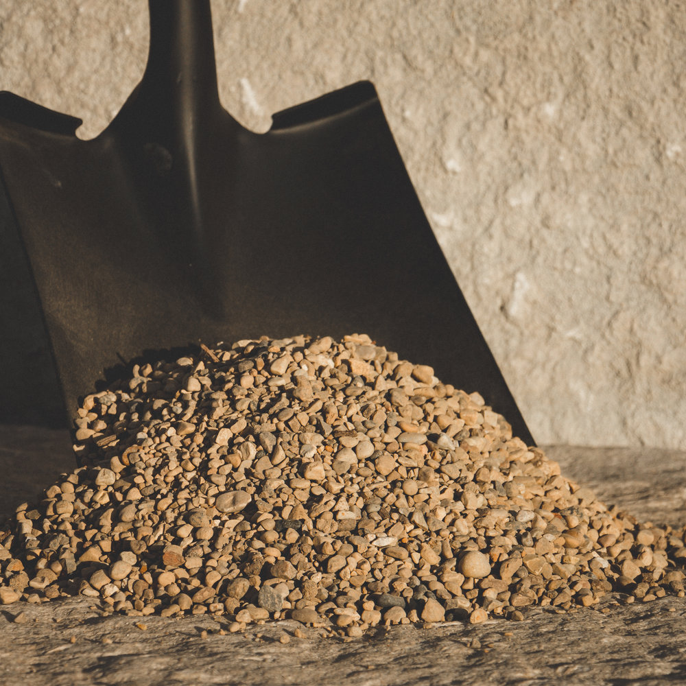 Pea Gravel - Small, smooth and round stone approximately 1/4