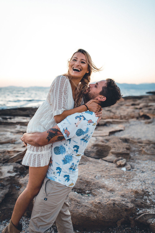 wedding photographer mallorca dominic lula couple lifting each other couple photoshoot engagement session