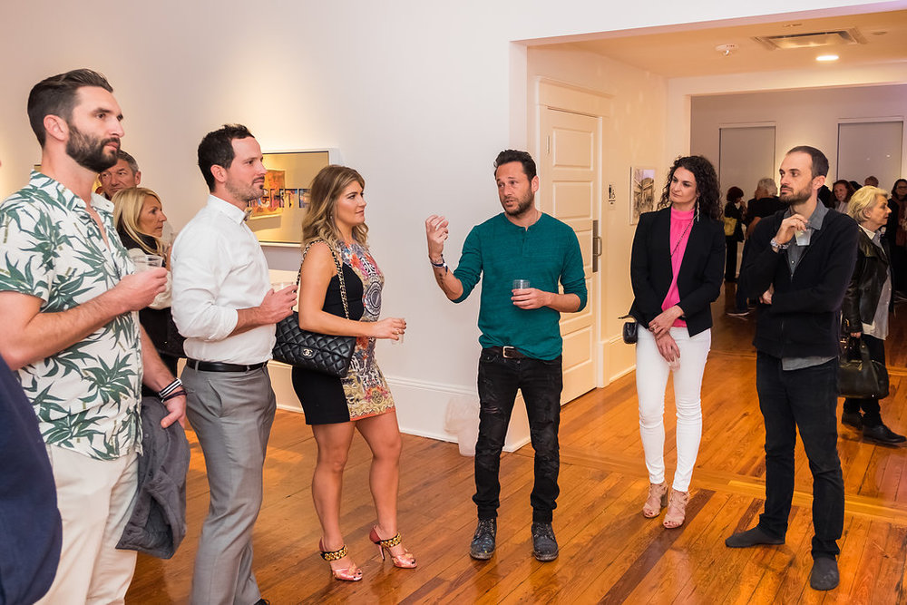 Artist  Jeremy Penn  (4th from left) describing his work to guests. Far right: Artist  Brookhart Jonquil  at the 2017 Beyond Art Basel party.
