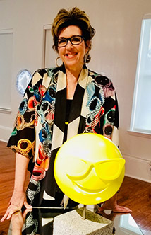 """MARCIA LEVINE - Museum AssistantOur newest team member, Marcia Levine, comes to us from New York with a strong background in media and event planning. She assists with running the Museum Store, helping with daily museum operations, and planning special events.Photo: Marcia LevinePhoto: Marcia Levine and Matthew LaPenta's """"Sunglass Face"""", October 2018."""