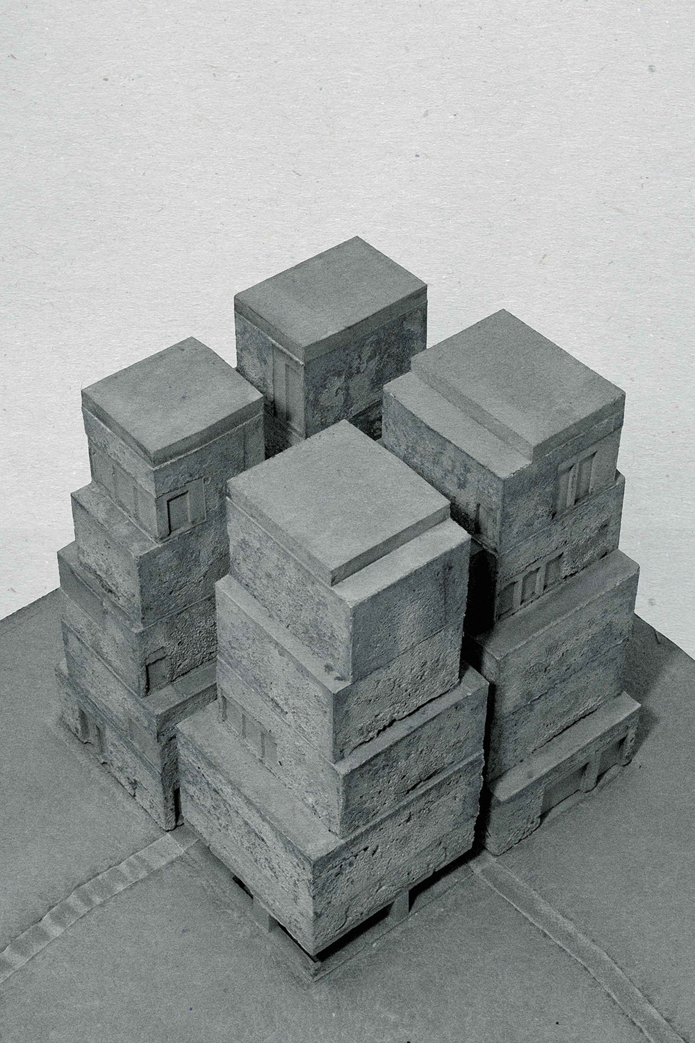 Study for a Depot in a Park Boijmans van Beuningen Museumpark, Rotterdam, 2014  The paradoxical design-assignment for an artdepot, a closed volume, within the open and natural conditions of a park is answered with four small towers. The project is mainly about the condition - the distance and proximity - between the towers. A public continuation of landscape and the walking routes in the park.