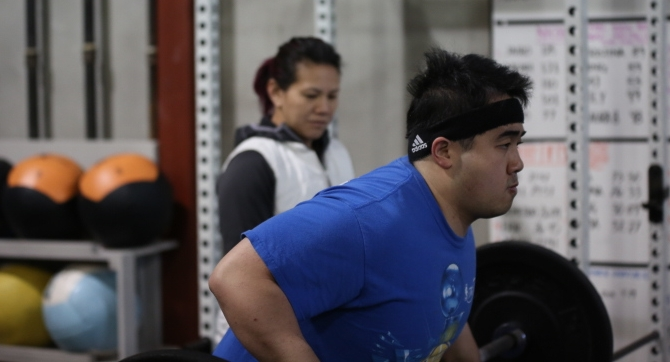 Joe doing row with Deanna in background.JPG