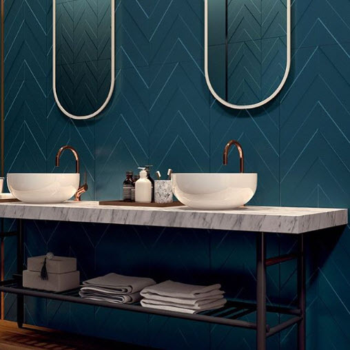 Matty Brum uses a simple Tile in a fabulous color as an accent wall behind the Vanity.