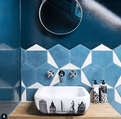 A very small amount of this ultra-interesting Tile goes a long way with an ultra-shiny painted finish on the rest of the walls in this Bathroom from Made About the House.
