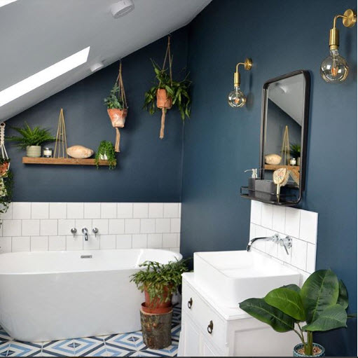 Scrumbles Living shows us here how simple can be beautiful. Using only a minimum amount of a standard issue white square tile, the painted walls in this bathroom that is tucked under the roofline with a glorious skylight and plants abundant, are stellar.