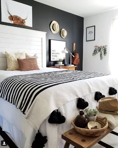 Cynthia Harper went bold with her Black Accent Wall in this Bedroom. A little does go a long way with this color scheme.