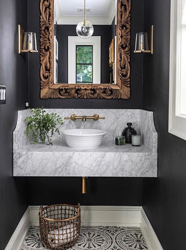Often you can take existing design elements and transform them incredibly with a coat of paint and a new light fixture. This Traditional Powder Room from Park and Oak Design looks stunning.