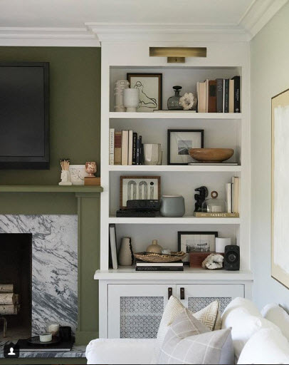 This Shelfie from Room for Tuesday is truly enhanced by the adjacent accent wall of green.