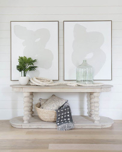 Kate Marker Interiors showcases a wonderfully soothing Tone on Tone Entry Vignette. Taking away contrast automatically calms a space because your eye physically moves around less.