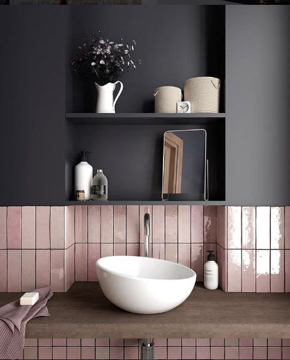 An Avant Garde Sink from Tons of Tiles and a great use of space in the niche above it. Those Pink tiles are snazzy but the Flat Dark Grey wall really pulls it all together.