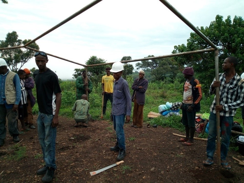 miningteam_setting up a tent.jpg