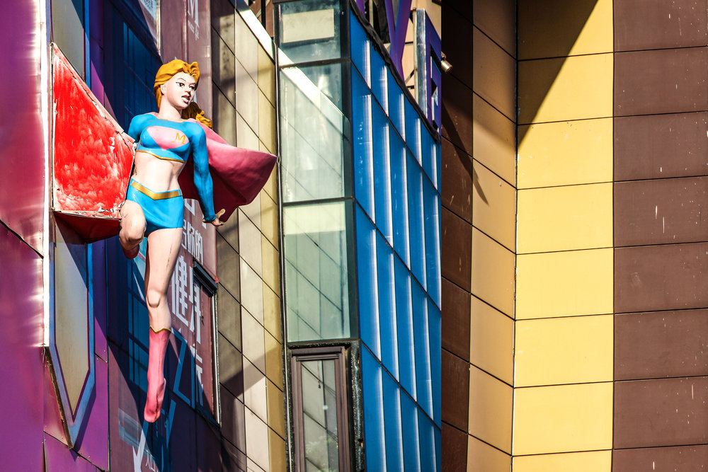 Image of a statue of superwoman.