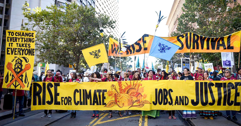 "On Sept. 8, thousands of people converged in San Francisco for the ""Rise for Climate, Jobs, and Justice"" march, just days before the Global Climate Action Summit, demanding a phase-out of fossil fuel extraction and a just transition to a 100% renewable energy economy. Photo credit: Brooke Anderson / Survival Media Agency"