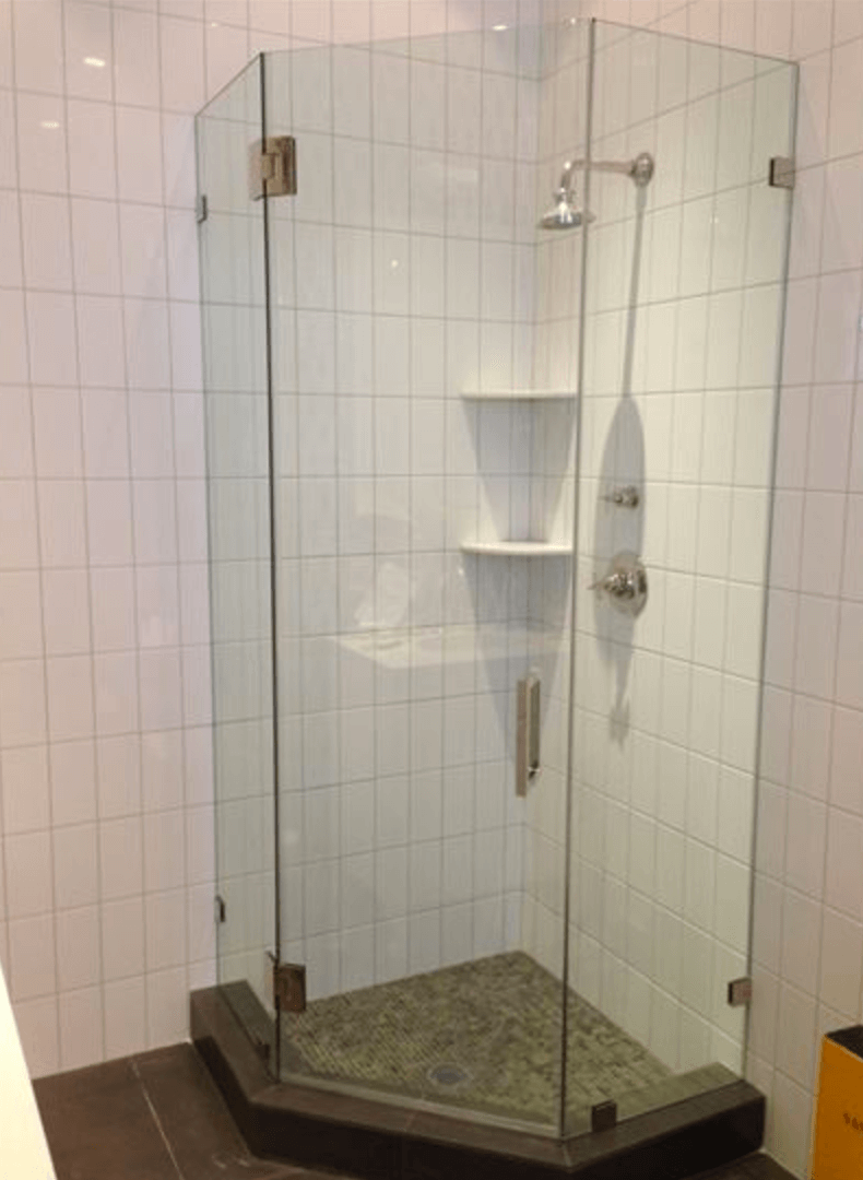 Three-sided glass bathroom enclosure