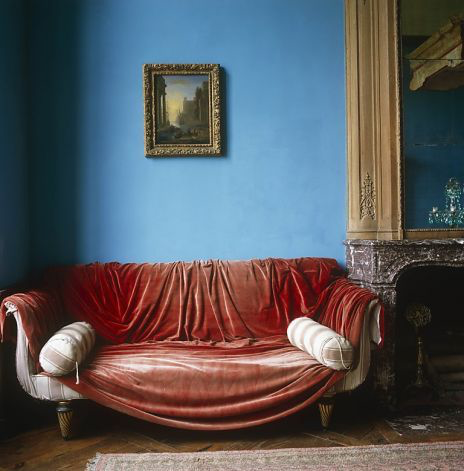 Excerpted from The Right Color by Eve Ashcraft (Artisan Books). A red velvet curtain is tossed casually over a Regency sofa in a room painted a powder blue  Photo  by Simon Upton