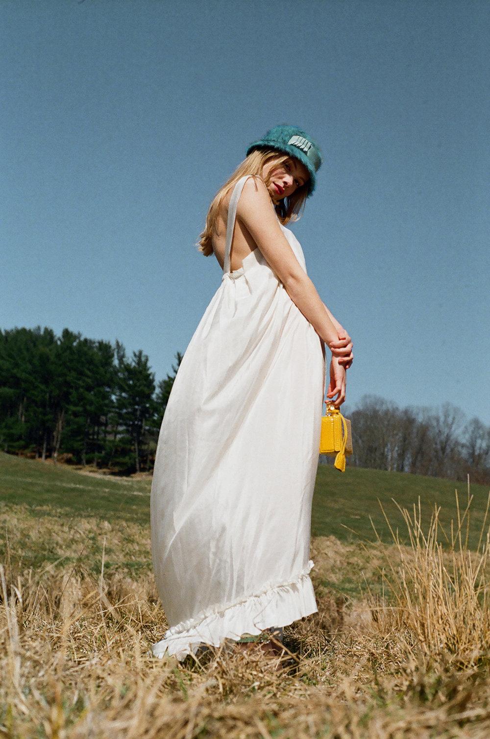 Hat,Albertus Swanepoel. Dress, Wendy Nichol. Bag, Mark Cross.