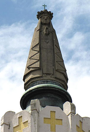 The 5,20 meter high statue of the Black Madonna on top of the dome of her church.