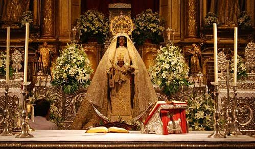 The Black Madonna placed behind the altar as if she was presiding at mass
