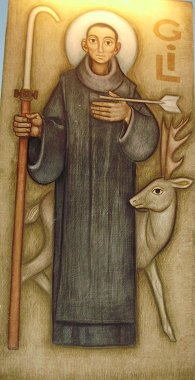 St. Gil and his only companion later in life: a deer whom he saved from hunters by intersepting their arrow with his body, which earned him the post of patron saint of cripples. A painting in the chapel of the Black Madonna.