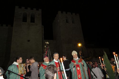 Before dawn on her great feast day, the procession arrives back at her church.