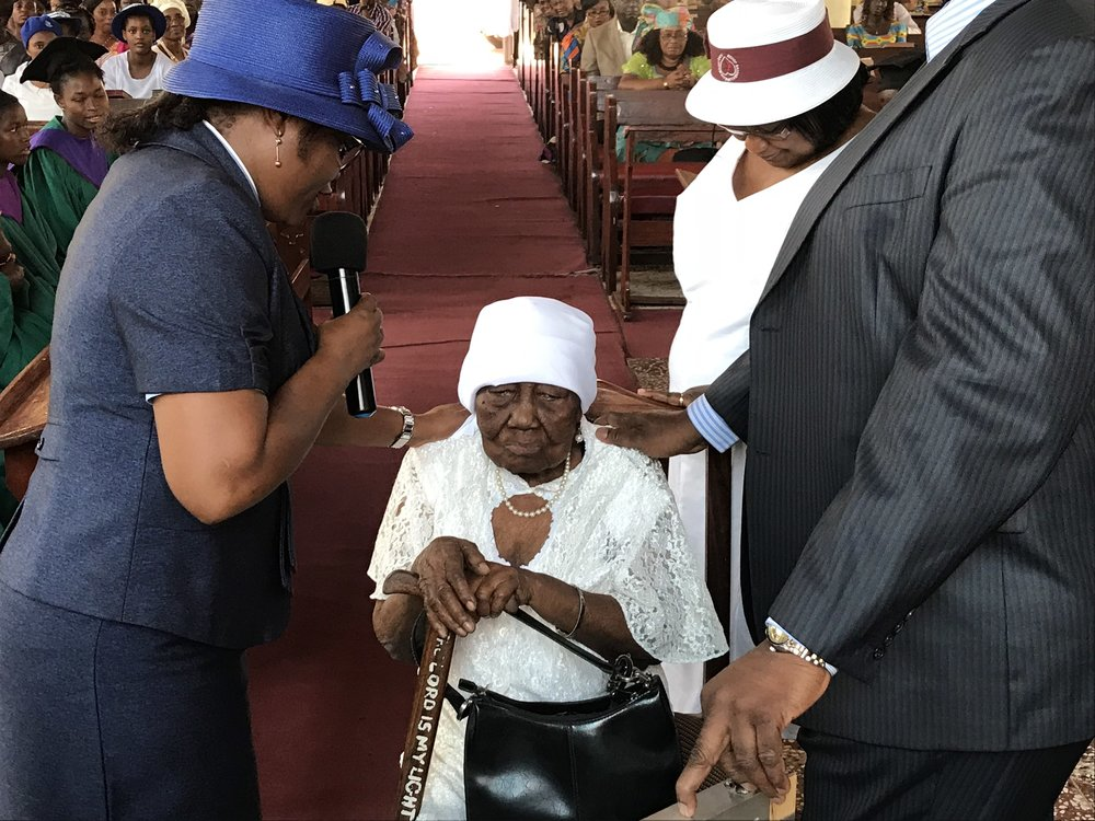 Receiving her blessing on her 97th birthday