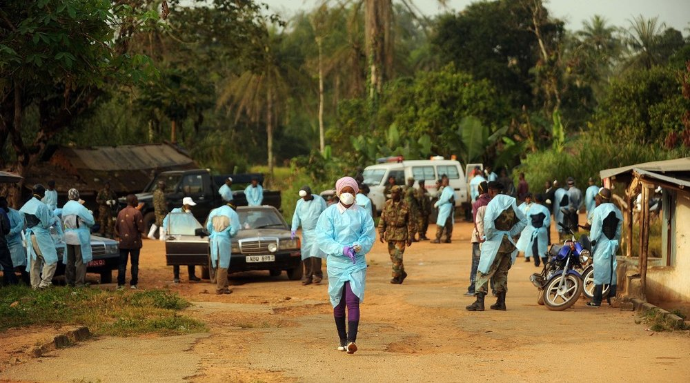 Photo by Michael G. Seamans  Sierra Leone military personnel and government healthcare workers begin a sweep in the village of Ndogboie in the Nimiyama Chiefdom in eastern Kono District on Sunday, Dec. 14, 2014.