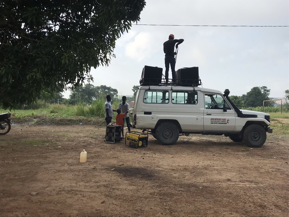Getting the truck ready for our march pass to open the camp.  We love a march pass in Salone.  Yes, those are speakers on top of the truck.  And they're powered by a generator that we take along inside the vehicle.
