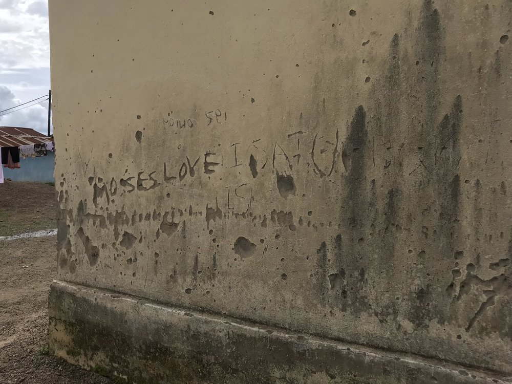 """Etched into the side of this house it reads, """"Moses loves Isatu"""".  I guess some things are universal."""
