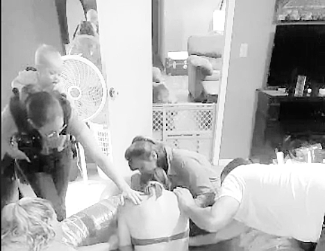 This a video screen shot of me putting my hand on the shoulder of a mama who is pushing and had started to get overwhelmed. I was reminding her, she was okay. (This is not a quality picture)