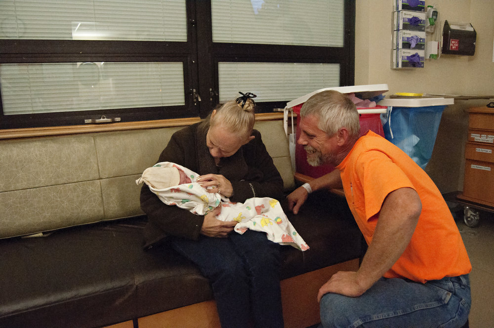 I captured this of my daughter, her dad and grandma. This was the last birth she attended, she passed away 6 months later.